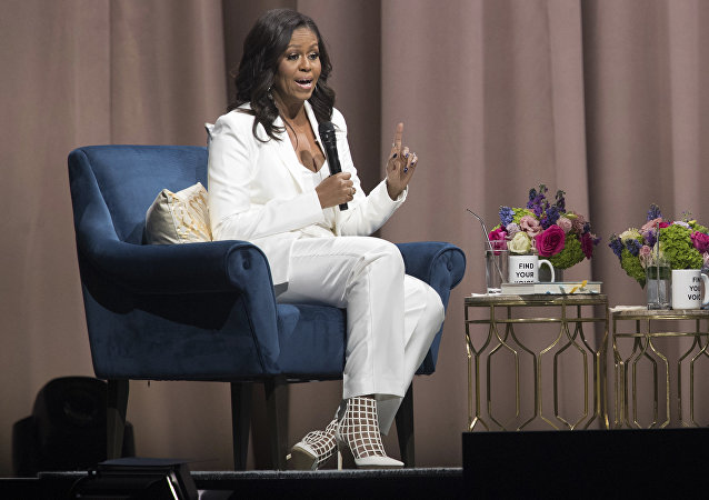Former first lady Michelle Obama speaks during the Becoming: An Intimate Conversation with Michelle Obama at Barclays Center in Saturday, Dec. 1, 2018, in New York