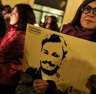 A woman holds up a picture of Giulio Regeni during a protest outside the Italian Parliament in Rome in 2017