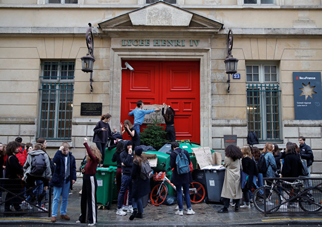 High school students block the entrance of the Lycee Henri IV secondary school to protest against the French government's reform plan, in Paris, France, December 6, 2018