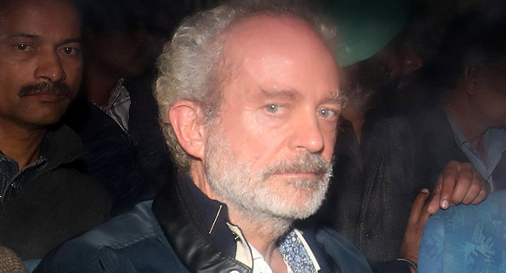 Christian Michel, a key accused and alleged middleman in India's abortive, scandal-tainted helicopter deal with Anglo-Italian firm Agusta Westland, is pictured inside a police vehicle outside a court in New Delhi, India, December 5, 2018