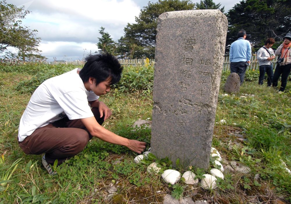 The Representative of Visa-Free Japan's Delegation at Old Japanese Cemetery on Yuzhno-Kurilsk in Kunashir Island