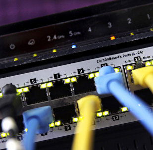 """In this June 19, 2018, file photo a router and internet switch are displayed in East Derry, N.H. Net neutrality traces back to an engineering maxim called the """"end-to-end principle,"""" a self-regulating network that put control in the hands of end users rather than a central authority"""