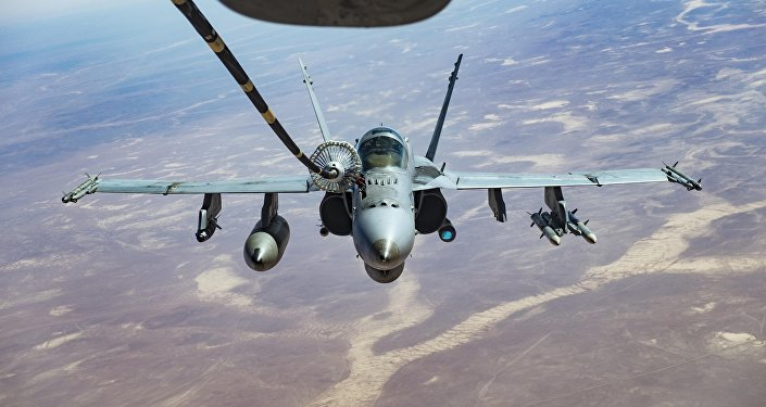 An F/A-18C receives fuel from a KC-10 Extender, one of the refueling aircraft belonging to US Central Command.