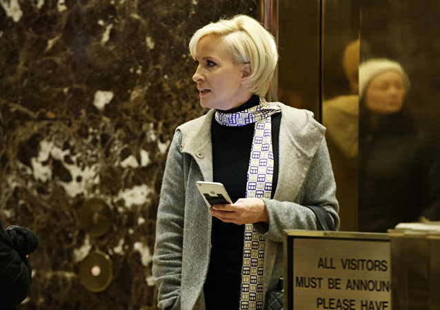 Mika Brzezinski waits for an elevator in the lobby at Trump Tower.