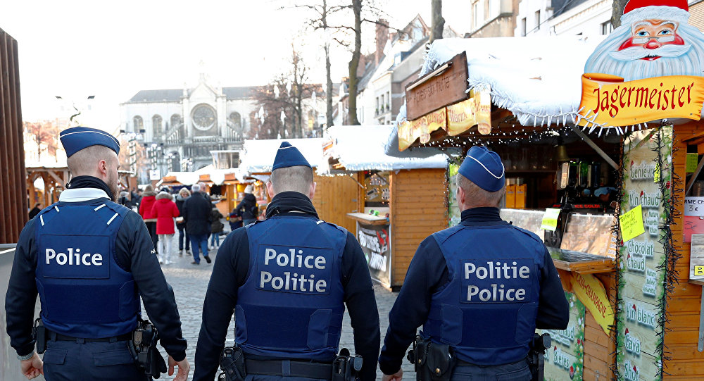 Belgian police officers patrol the area of Christmas market in central Brussels, Belgium, December 12, 2018