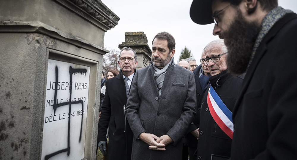 French Interior Minister Christophe Castaner, center, attends a ceremony at the Jewish cemetery of Herrlisheim, near Strasbourg, eastern France, with Strasbourg Rabi Harold Weill, right, and local mayor Louis Becker, second right, Friday, Dec.14, 2018.