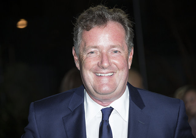 Piers Morgan poses for photographers upon arrival at the GQ magazine Awards at the Tate Modern in London, Tuesday, Sept. 6, 2016