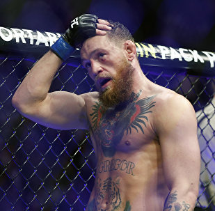 Conor McGregor reacts after losing to Khabib Nurmagomedov in a lightweight title mixed martial arts bout at UFC 229 in Las Vegas, Saturday, Oct. 6, 2018