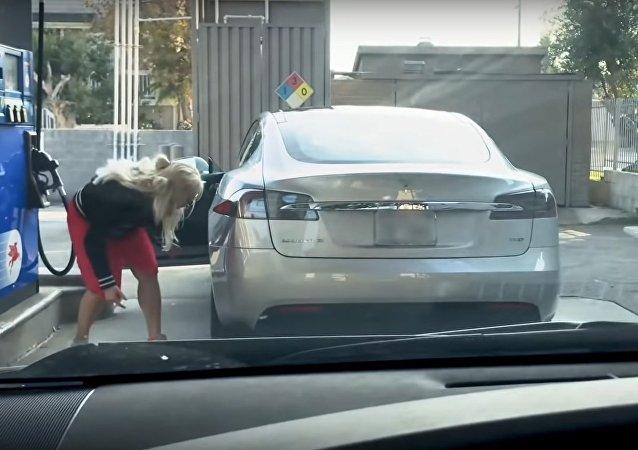 Blonde, Tesla and Gas Station?