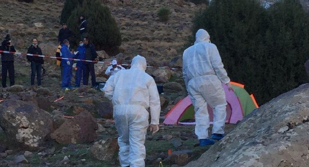 In this photo provided by Moroccan news channel 2M and taken on Tuesday, Dec. 18, 2018, a forensic team is seen at the area where the bodies of two Scandinavian women tourists were found dead, near Imlil in the High Atlas mountains, Morocco