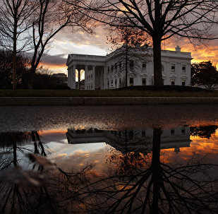 The sun rises behind the White House in Washington, Saturday, Dec. 22, 2018. Hundreds of thousands of federal workers faced a partial government shutdown early Saturday after Democrats refused to meet President Donald Trump's demands for $5 billion to start erecting a border wall with Mexico