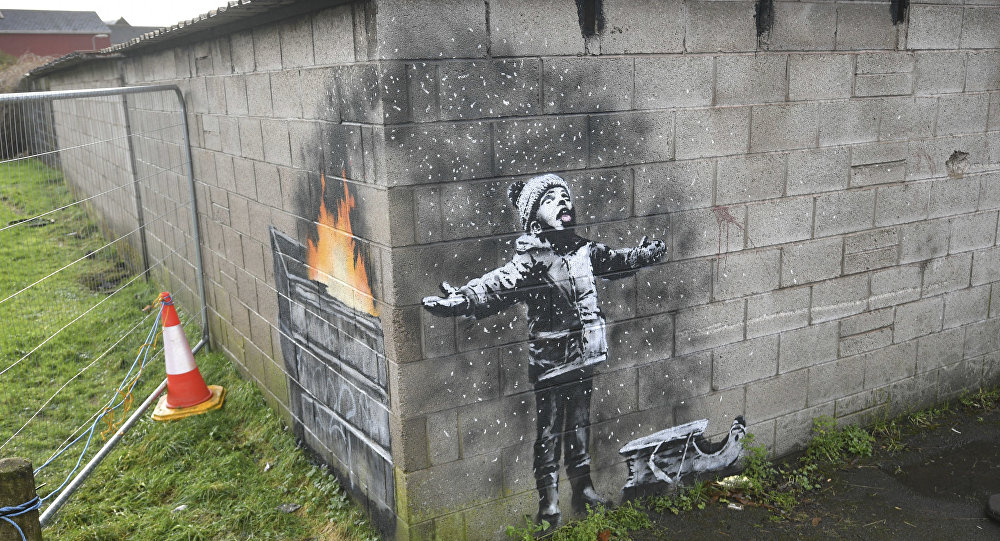 Banksy's 'Season's Greetings' protected with plastic