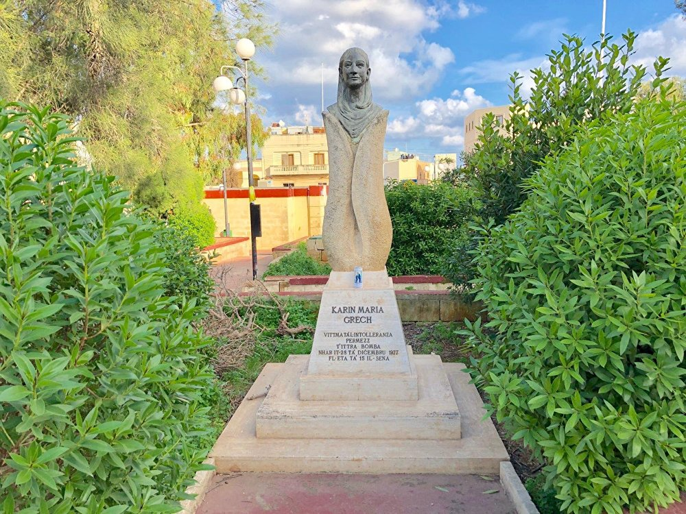 Flowers are laid at the foot of this statue of Karin Grech in San Gwann, Malta every Christmas