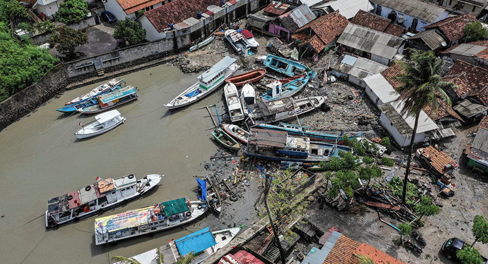 Stranded boats are seen near houses after a tsunami hit at Anyer in Banten, Indonesia, December 24, 2018 in this photo taken by Antara Foto