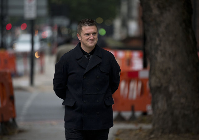 Tommy Robinson, the former leader of the right-wing EDL group, arrives for an appearance at Westminster Magistrates Court in London, Wednesday, Oct. 16, 2013