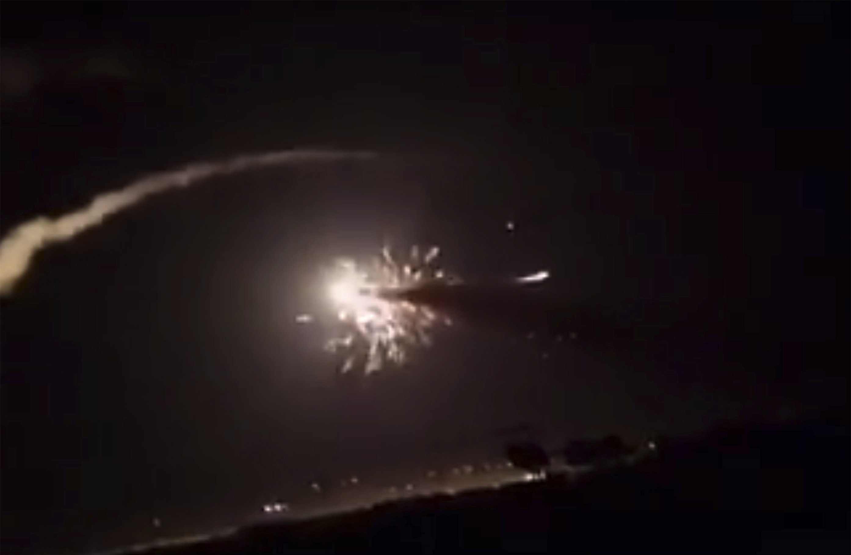 This frame grab from a video provided by the Syrian official news agency SANA shows missiles flying into the sky near Damascus, Syria, Tuesday, Dec. 25, 2018.