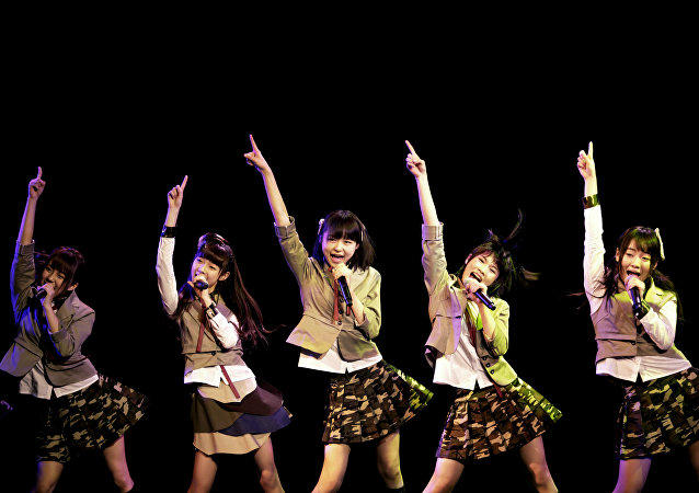 In this photo taken Saturday, Jan. 12, 2013, members of SNH48, a Shanghai-based Chinese girls group, perform during their first appearance on stage in Shanghai, China. They are a newly-launched sister group of Tokyo-based AKB48