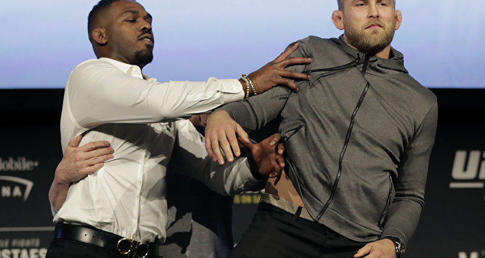 Jon Jones, left, pushes Alexander Gustafsson out of the way during a news conference about their light heavyweight bout, Friday, Nov. 2, 2018, at Madison Square Garden in New York. The two will fight in UFC 232, which is scheduled for Dec. 29, 2018, in Las Vegas.