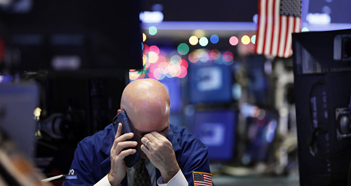 A trader talks on his phone on the floor of the New York Stock Exchange