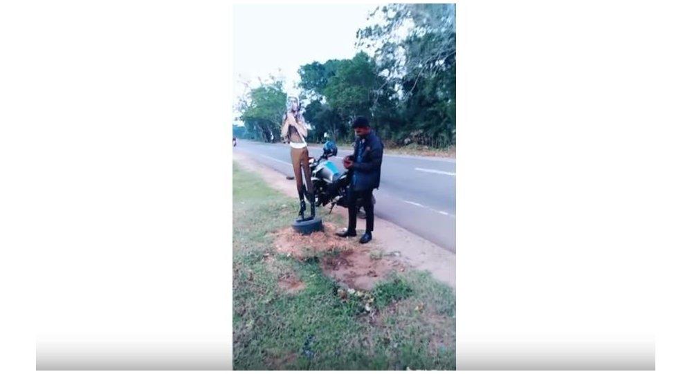 Man Bribing Offer to Cardboard Cop in Sri Lanka