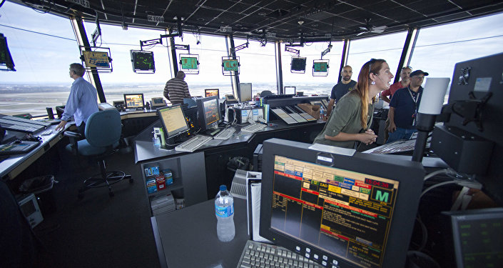 FAA Air Traffic Controllers work in the Dulles International Airport Air Traffic Control Tower in Sterling, Va