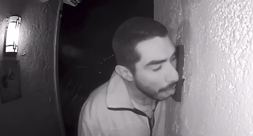 33-year-old Roberto Daniel Arroyo is caught on security footage licking a family's doorbell for three hours early Saturday morning