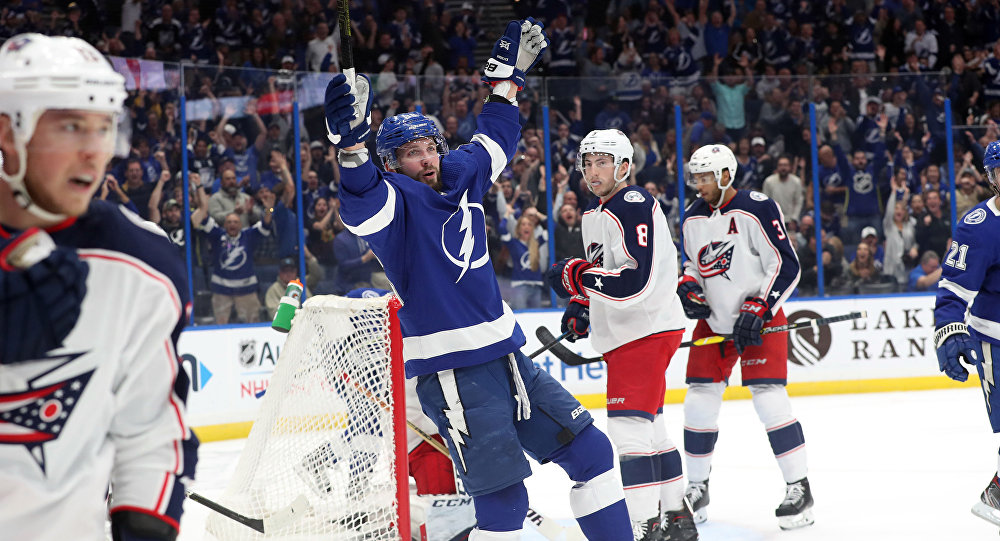 Jan 8, 2019; Tampa, FL, USA; Tampa Bay Lightning right wing Nikita Kucherov (86) celebrates after assisting on a goal by center Brayden Point (not pictured) against the Columbus Blue Jackets during the first period at Amalie Arena