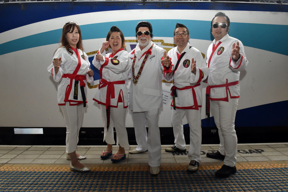 Mayor of Parkes Ken Keith (C) Poses with Elvis Fans from Japan Before Boarding the Elvis Express