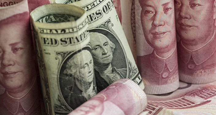 Chinese 100 yuan notes and one US dollar notes in Beijing