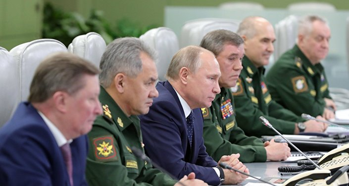 December 26, 2018. Russian President Vladimir Putin watches the launch of the Avangard missile with hypersonic gliding cruise bloc at the National Defense Control Center via a video conference.