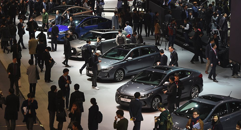 Visitors look at cars during a press preview of the Seoul Motor Show in Goyang, northwest of Seoul, on March 30, 2017