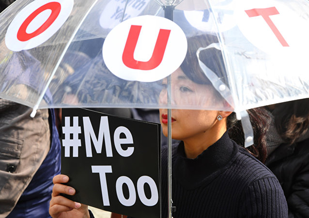 A South Korean demonstrator holds a banner during a rally to mark International Women's Day as part of the country's #MeToo movement in Seoul on March 8, 2018.