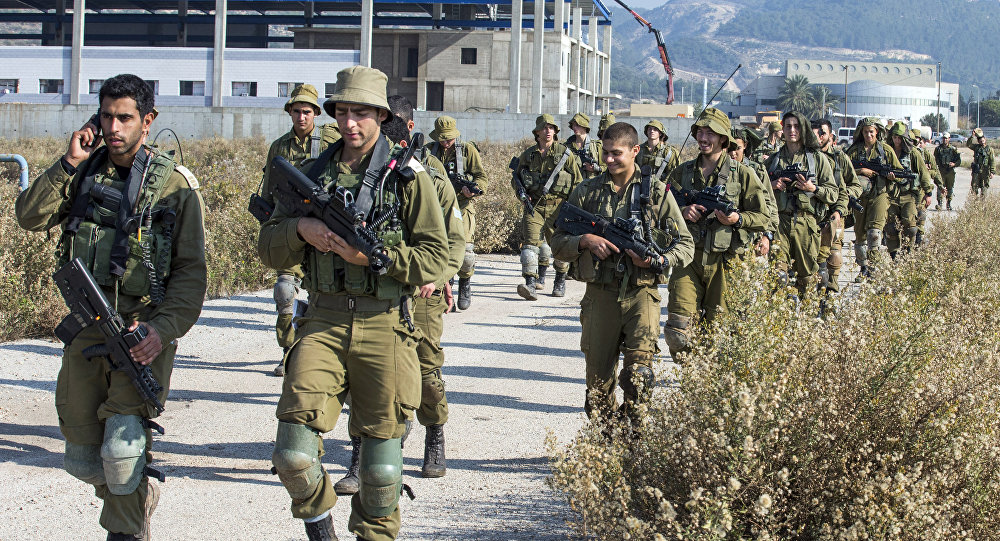 Israeli soldiers patrol the northern Israeli-Lebanon border