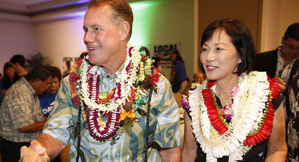 Rep. elect Ed Case, D-Hawaii, right, and his wife Audrey Nakamura Case, greet supporters Tuesday, Nov. 6, 2018, in Honolulu