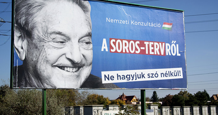 A billboard with a poster of Hungarian-American billionaire and philanthropist George Soros with the lettering National consultation about the Soros' plan - Don't let it pass without any words is seen in the 22nd district of Budapest on October 16, 2017