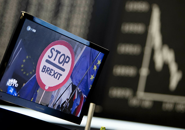 A computer screen shows news about the Brexit as the curve of the German stock index DAX is seen at the stock market in Frankfurt, Germany, Wednesday, Jan. 16, 2019