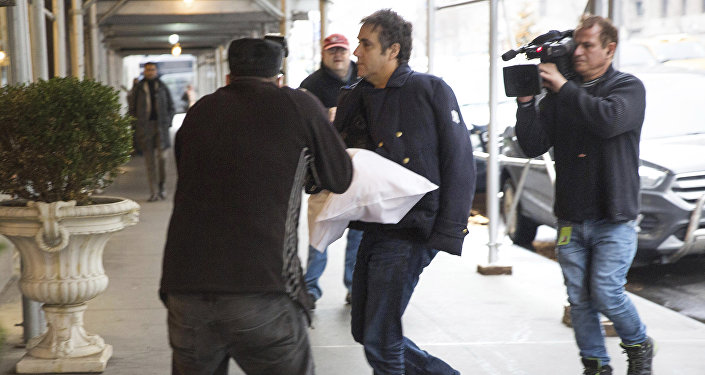 Michael Cohen arrives at his home in New York with his left arm in a sling supported by a pillow Friday, Jan. 18, 2019. Democrats are vowing to investigate whether President Donald Trump directed Cohen, his personal attorney, to lie to Congress about a Moscow real estate project, calling that possibility a concern of the greatest magnitude.