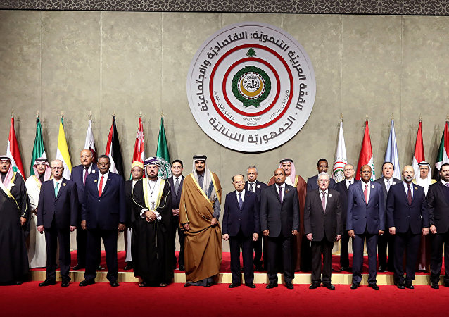 Arab leaders pose for the camera, ahead of the Arab economic summit in Beirut, Lebanon January 20, 2019.