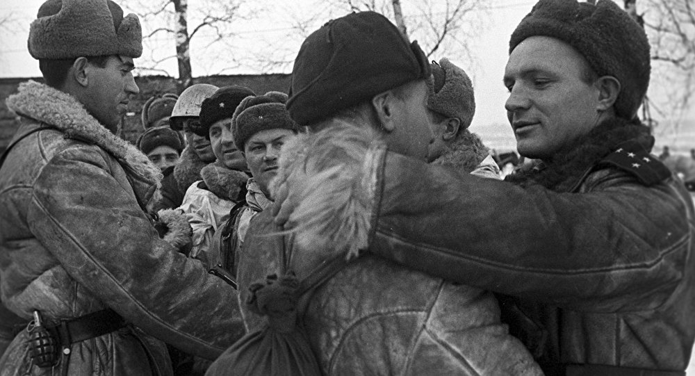 Red Army soldiers greet one another after an operation to lift the siege of Leningrad.