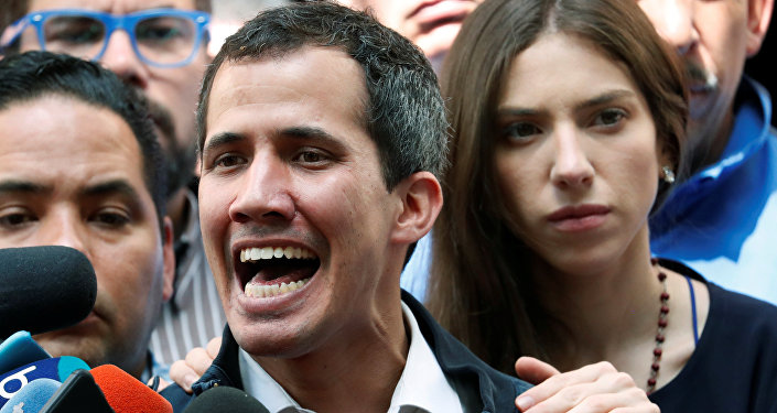 Venezuelan opposition leader and self-proclaimed interim president Juan Guaido accompanied by his wife Fabiana Rosales, speaks to the media after a holy mass in Caracas, Venezuela, January 27, 2019
