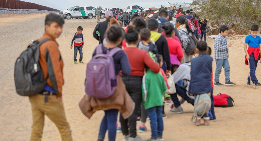 A large group of 376 migrants wait in line to be processed after being detained by U.S. Customs and Border Protection after crossing the United States- Mexico border near Yuma, Arizona, U.S., January 14, 2019. Photo taken January 14, 2019