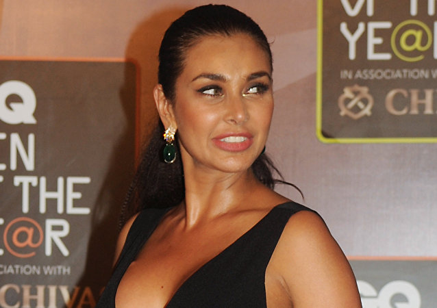 Canadian and Bollywood actress Lisa Ray attends the GO Men of the Year Awards in Mumbai on September 26, 2015