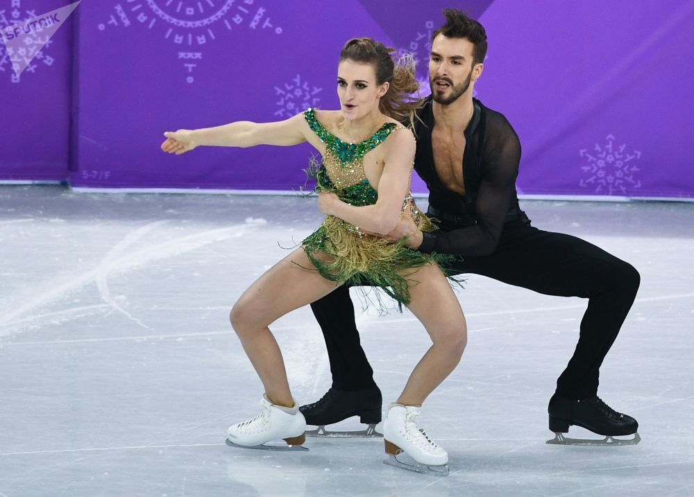 Gabriella Papadakis and Guillaume Cizeron Take Part in Short Dance Program on Ice During Contest at  XXIII Winter Olympic Games