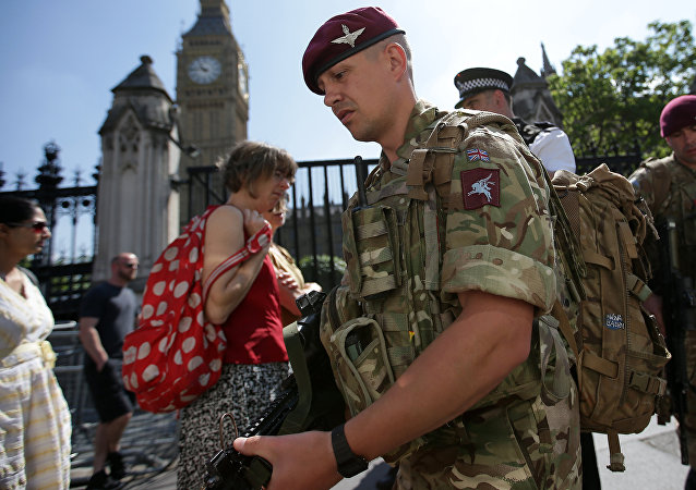 British Army soldiers from the Parachute regiment patrol the streets near the Palace of Westminster, comprising the Houses of Parliament and the House of Lords, in central London, on May 25, 2017, following the May 22 terror attack at the Manchester Arena.