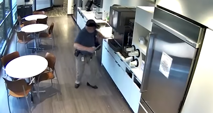 Alexander Goldinsky, 57, in security footage of his alleged fall in a New Jersey cafeteria, which prosecutors allege was faked