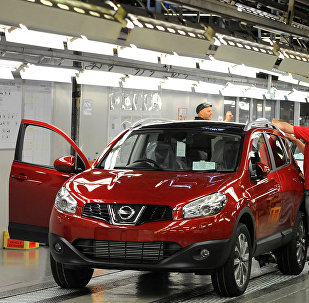 FILE PHOTO: A worker is seen completing final checks on the production line at Nissan car plant in Sunderland, northern England, June 24, 2010.