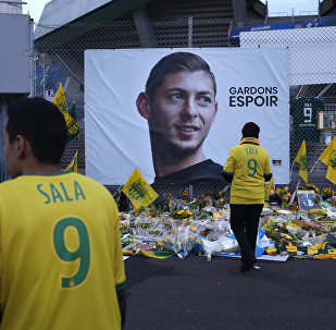 Nantes soccer team supporters stand by a poster of Argentinian player Emiliano Sala and reading Let's keep hope outside La Beaujoire stadium before the French soccer League One match Nantes against Saint-Etienne, in Nantes, western France, Wednesday, Jan.30, 2019