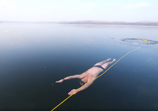 Thrills & Chills: Czech Freediver Swims Under Clear Frozen Lake