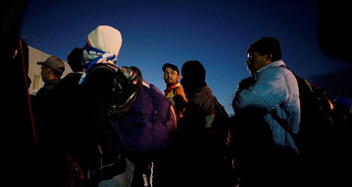 Migrants listen to Mexican authorities in a provisional shelter during their journey towards the United States, in Piedras Negras, Mexico, February 4, 2019.