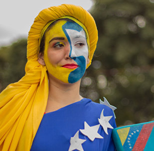 A woman takes part in a rally in support of the Venezuelan President Nicolas Maduro, in Caracas, Venezuela